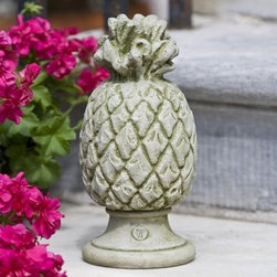 Campania International Williamsburg Pineapple Finial Cast Stone Garden Statue - About Campania InternationalEstablished in 1984, Campania International's reputation has been built on quality original products and service. Originally selling terra cotta planters, Campania soon began to research and develop the design and manufacture of cast stone garden planters and ornaments. Campania is also an importer and wholesaler of garden products, including polyethylene, terra cotta, glazed pottery, cast iron, and fiberglass planters as well as classic garden structures, fountains, and cast resin statuary.Campania Cast Stone: The ProcessThe creation of Campania's cast stone pieces begins and ends by hand. From the creation of an original design, making of a mold, pouring the cast stone, application of the patina to the final packing of an order, the process is both technical and artistic. As many as 30 pairs of hands are involved in the creation of each Campania piece in a labor intensive 15 step process.The process begins either with the creation of an original copyrighted design by Campania's artisans or an antique original. Antique originals will often require some restoration work, which is also done in-house by expert craftsmen. Campania's mold making department will then begin a multi-step process to create a production mold which will properly replicate the detail and texture of the original piece. Depending on its size and complexity, a mold can take as long as three months to complete. Campania creates in excess of 700 molds per year.After a mold is completed, it is moved to the production area where a team individually hand pours the liquid cast stone mixture into the mold and employs special techniques to remove air bubbles. Campania carefully monitors the PSI of every piece. PSI (pounds per square inch) measures the strength of every piece to ensure durability. The PSI of Campania pieces is currently engineered at approximately 7500 for optimum strength. Each pie