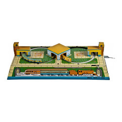 Train Wind-Up Toy - Vintage tin litho wind-up toy with two trains that circle into the stations.