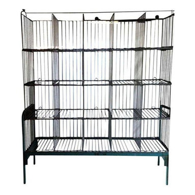 Pre-owned 1950s Steel Laundry Storage Rack - Significant storage for your home, office, cottage and beyond with this vintage steel stand of basketry. This piece hails from an east coast commercial laundry facility, circa 1950s. It can be dismantled for transport. Interested in more than one? We have two available. Please contact support to purchase the lot.