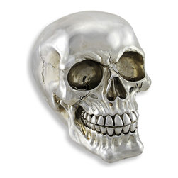 Skullplanet - Chrome Silver Finish Human Head Skull Statue Figure - Add some morbid glamour to your decor This wickedly awesome human skull statue has a mirror-like silver chrome finish. Made of cold cast resin, it has the look of real metal. The figure stands 4 1/2 inches tall, is 4 inches wide and 6 inches deep, and has a felt bottom to prevent scratching delicate surfaces. It makes a great everyday or Halloween decoration, and is a great gift for any skull lover.