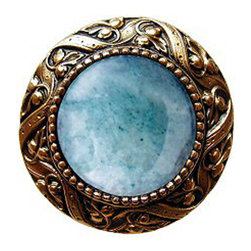 "Inviting Home - Victorian Knob (24K gold plate with green aventurine) - Victorian Knob in 24K gold plate with green aventurine semi-precious stone 1-3/8"" diameter Product Specification: Made in the USA. Fine-art foundry hand-pours and hand finished hardware knobs and pulls using Old World methods. Lifetime guaranteed against flaws in craftsmanship. Exceptional clarity of details and depth of relief. All knobs and pulls are hand cast from solid fine pewter or solid bronze. The term antique refers to special methods of treating metal so there is contrast between relief and recessed areas. Knobs and Pulls are lacquered to protect the finish. Alternate finished are available. Green Aventurine Semi-precious stone. Aventurine is a stone of microcrystalline quartz. Any mice inclusions give the Aventurine stone a more silvery look to it. The Green Aventurine stone is native to India Chile Spain Russia Brazil Austria and Tanzania. It is thought to improve a person�s near-sightedness as well as being a gambler�s stone. Is the stone which pretends to Libra it is also the planetary stone of Taurus. Victorian Jewel pulls and knobs will allow you to have so much fun with the design. The pulls and knobs come in five different kinds of semi-precious stones: Black Onyx Tiger Eye Blue Sodalite Red Carnelian and Green Aventurine. You can even use all of the different colors of the semi-precious stones on one cabinet fa�ade�which would give it an eclectic and playful look."