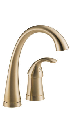 "Delta - Delta 1980-CZ-DST Pilar Series Single-Handle Widespread Bar/Prep Faucet - The Delta 1980-CZ-DST is a Pilar Series Single-Handle Widespread Deck-Mounted Bar/Prep Faucet. This high-arc bar faucet provides a graceful functionality and a sleek design, coupled with the latest valve technology, and it coordinates perfectly with the Pilar Waterfall Kitchen Faucet. It has a 6-5/8"" long, 9-1/2"" tall spout with a 180-degree turning radius, and a Quick Snap hose for easy installation. It features Delta's DIAMOND Seal Technology for lasting durability, and is ADA/CALGreen compliant. This model comes in an elegant Champagne Bronze finish."