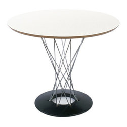 Isamu Noguchi Cyclone Dining Table - Originally designed as a rocking stool, Isamu Noguchi adopted his iconic design to become a dining table a few years later. The steel pedestal, wood top and black porcelain-finished foot are a fascinating and eye-catching assemblage of materials.