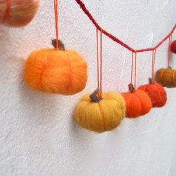 Fall Pumpkins Garland by Sewn Natural - I would hang these near the kids' table. I like their bright fall colors and sweet handmade look.