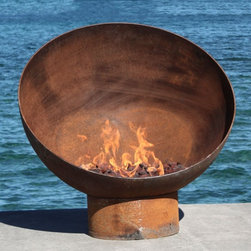 The Meridian Firebowl - This massive firepit looks like an egg chair with a fire in its seat. The rusted steel has a worn in look that makes you think it's been there for years. The design has a very city, industrial feel to it.