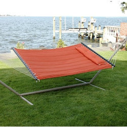Bliss Hammocks - Bliss Hammocks Quilted Hammock with Pillow - BQH-470 - Shop for Hammocks from Hayneedle.com! Listen to the call of the summer sun and turn off the TV shut down the computer get out of the house and into the comforting embrace of a Bliss Hammocks Quilted Hammock with Pillow. You'll be glad you did. Work on your tan read a book or simply enjoy the relaxing feel of the soft cotton quilted fabric. UV treated this hammock's color will last for many summers while the mold- and rot-resistant polyester rope will stay strong year after year. The non-decaying hardwood spreader bar features a rich mahogany finish and keeps your hammock open and ready for you at all times. A detachable button tuft pillow cradles your head relaxing the neck. Perfect for one or two people this hammock comes complete with galvanized heavy gauge steel chains and S-hooks that resist rust and let you adjust your hammock to the ideal height. Choose from a variety of color options to match your summer vibe. About Bliss HammocksWith four years of wholesale business experience Bliss Hammocks has successfully created and marketed a unique line of hammocks hammock chairs and outdoor recreational products that offer a winning combination of top-quality workmanship and state-of-the-art packaging and design. With a full line of hammocks drawing interest from an assortment of industries and markets Bliss hammocks has gained recognition in spa and resort shops drug store chains gift shops sporting good chains and more. Quality is of utmost importance. Bliss Hammocks products are personally inspected for quality to ensure each one is in line with every customer's high expectations.