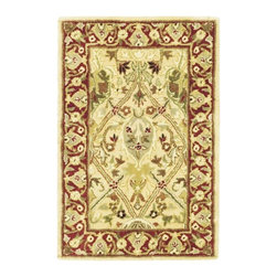 Safavieh - Traditional Accent Rug - Hand tufted weave. Intricate Tabriz, Lavar Kerman and Isfahan hand-knotted motifs. Made from wool. Ivory and rust color. Made in India. Pile height: 0. 63 in. Overall: 3 ft. L x 2 ft. W. Inspired by the legendary designs of Persia's most prestigious rug-weaving capitals, these extraordinary reproductions recreate some of the most prized antiques in Safavieh's archival collection. Care Instructions: Vacuum regularly. Brushless attachment is recommended. Avoid direct and continuous exposure to sunlight. Do not pull loose ends clip them with scissors to remove. Remove spills immediately; blot with clean cloth by pressing firmly around the spill to absorb as much as possible. For hard-to-remove stains professional rug cleaning is recommended.