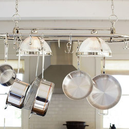 Sawyer Pot Rack Pendant - Transform a kitchen counter into a work space worthy of a pro. This fixture combines two ribbed-glass pendants with a rack that holds multiple pots and pans. The pendants cast bright, focused light that's ideal for tasks such as chopping and measuring.