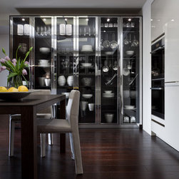 SieMatic BeauxArts.02 - This image contains detail of the BeauxArts.02 nickel tall cabinets.  The tall cabinets feature veneer interiors and customizable shelving options.
