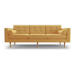 Joybird Furniture - Braxton Sofa - Bentley Daisey Yellow - Button tufting and matching bolsters impart a casual elegance on this Mid-Century inspired piece, dressing up any room it's placed in.With plush bolsters on either side, the Braxton Sofa was created for comfortable lounging. And yes - even afternoon snoozes. We care about our planet. Our products are either certified organic, recycled, rapidly renewable, non-toxic, reclaimed, or responsibly produced.Frame: Kiln dried hardwood. Once assembled, frames are wrapped in 2lb foam exceeding industry standards. Made with responsibly-sourced wood. Legs: Solid beechSuspension: Seat - zig zag springs. Back - spring backJoints: Glued, stapled and screwed to ensure frame stability and longevity.Assembly: Screw on legsStyle: Loose back; loose bench seatCushions: Contain no flame retardants or harmful chemicals. Glue and Stains: Water-based, low-VOC