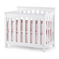 """Nursery Smart - Ethan 2-in-1 Convertible Mini Crib - The Ethan petite 2-in-1 convertible crib is as sophisticated as it is functional. It is an ideal space saving solution for any nursery. Handcrafted by skilled wood workers with over 3 decades of woodwork experience. This mini portable size baby crib is designed and constructed to withstand the test of time. This mini crib is ideal for tighter spaces as it is lighter and smaller than a standard size crib. Converts from a petite crib to twin size bed with optional conversion kit in white finish sold separately. Features: -Ethan collection. -Child safe non-toxic finish. -Material: 100% wood. -No veneer or laminate components. -Adjustable to 4 levels of mattress support as your child grows. -No moving parts allows for a safer crib for you and your baby. -Converts to twin size bed with optional conversion rails. -Mini crib or port-a-crib mattress pads will fit in this petite crib. -Ideal for nursery with limited space. -Meets and exceeds all U.S. safety requirements. -Easy to follow instructions. -Optional Full-Size Bed Conversion Rails are constructed of Pine wood and convert all full size cribs into full size beds and convert all petite or mini cribs into twin size beds. -This is a NON-Drop Side crib. Dimensions: -Overall: 38"""" H x 42"""" W x 26"""" D, 40 lbs. -Twin Size / Full-Size Bed Conversion Rails: 77"""" H x 5"""" W x 3"""" D, 16 lbs."""