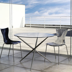 Maddox Dining Chair - Maddox dining chair features colored polycarbonate seat on fixed x-leg pedestal base. Base made of stainless steel. Measures 20 x 20 x 33. Available in multiple colors. Made in Brazil. Imported.