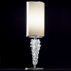 AXO Light - Subzero Table Lamp by AXO Light - Like a cluster of icy rock candy, the Bohemian crystal on the stem of the AXO Light Subzero Table Lamp looks cool and sweet. Sparkling below the cylindrical shade, it refracts lights while also adding unique texture to the fixture. The shade is available in either red, White or vanilla fabric or chrome. Italy's AXO Light combines traditional Venetian glasswork and artisan craftwork with avant-garde lighting techniques and innovative materials. Their design philosophy is clear: use creativity and inspiration to create stunning lighting replete with value and emotion.