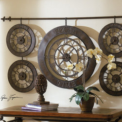 Products From Previous Projects - This array of clocks is hung from a wrought iron rod.