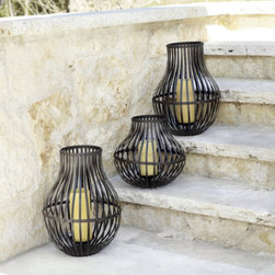 Iron Hurricane - Elegant, yet durable, traditional but with an industrial, modern twist, you'll love the look of these fabulous iron hurricanes.  Use them in multiples along a stairway, scattered around a patior or atop  a rock wall.  Or, place them on an outdoor table for a great centerpiece.
