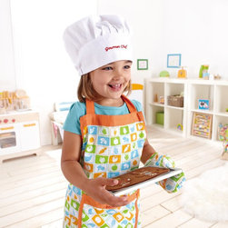 Hape - Hape Chefs Apron Set Multicolor - E3119 - Shop for Cooking and Housekeeping from Hayneedle.com! Your little one will sure look like a master chef at work after donning the Hape Chefs Apron Set. The chef's apron hat and oven mitts are just the accessories budding chefs need to emulate mom and dad as they rustle up favorite family menus. Made of 20% cotton 80% polyester fabric this apron set engages your child in imitative and imaginary play fantasy storytelling role playing and creativity while encouraging social skills through communication cooperation collaboration trust-building and language development.About Hape InternationalDrawing on decades of child development expertise Hape (pronounced hah-pay) International is sensitive to children's needs whenever they develop and design a new toy. Their toys support children throughout every stage of development. This support starts at a very young age to help nurture and develop their natural abilities. Hape International's first priority is to encourage children in their individual development through building their self esteem. With their high-quality toys and games they support children as they play learn interact and grow. Hape understands that children's social emotional intellectual and physical health is a key issue not only for parents but also for a healthy society. That's why they take this responsibility very seriously and conduct a wide range of toy safety tests. The result is safe exciting stimulating toys.