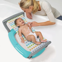 Babys Journey - Babys Journey Whale March Bath Hammock Multicolor - 1020 - Shop for Bath Tubs and Bathers from Hayneedle.com! If we could put a hammock in our bath we'd definitely do it but until they loosen up the building codes you can let your baby enjoy some soothing hammock time with the Babys Journey Whale March Bath Hammock. This stable and low-maintenance bath hammock provides comfort and security keeping your baby calm and relaxed during bath time. From their first day home from the hospital to the first day they can sit up by themselves the simple compact design with become a regular feature in your daily routine. The patented roller-sling easily retracts into the secure base which folds for travel and storage. Simply wash the sling with warm water and mild soap then after a bit of air-drying its time. for your next bath.About Baby's JourneyThe Baby's Journey team has a diverse background that includes a designer from Hasbro's G.I. Joe line and a board of directors with a combined total of over 20 000 changed diapers. They know what parents need because they're all parents who've needed the kind of products that Baby's Journey delivers every day. By using innovative processes and a bit of creativity in everything they do Baby's Journey produces unique and effective everday items like changing pads bathing accessories and travel items that make life with a new baby as enjoyable as it ought to be.