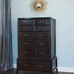 Brownstone Inc. - Marin Highboy 8 Drawer Chest Multicolor - BRW202 - Shop for Dressers from Hayneedle.com! Carefully crafted from a unique blend of plantation-grown mahogany and environmentally-sustainable bamboo laminates the Marin Highboy Chest offers beauty durability and textures anyone will appreciate. The beauty of laminated bamboo is its natural cracked surface which should not be mistaken for a manufacturer defect. A rich Cappuccino finish ties these two materials together seamlessly. The Marin Highboy Chest features eight drawers of various sizes to give you exceptionally organized storage. Each drawer features dovetail construction for added strength and are equipped with spring-loaded soft roller slides for easy opening and closing. Drawers are fully finished on the inside.About BrownstoneBrownstone's mission is to create quality manufactured furniture with innovative and timeless designs. The people of Brownstone pride themselves on ensuring that the highest quality standards are met when building their furniture. Based in Richmond Calif. they select the finest-grade environmentally friendly woods and use only American-made finishing materials. From bedroom collections to dining and occasional pieces Brownstone's signature is to artfully blend the classic look of traditional furniture with the clean lines of contemporary design. Brownstone's intention is to offer its customers high-design furniture that endures the test of time and is uncompromised in quality.