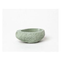 "Stone Fruit Planter, Avocado - Handmade in New York, this stone fruit planter is made out of fine cement in immitating fruit textures. Slight variations in shape and weight occur from planter to planter, just like acutal pieces of fruit. ""All of our planters are made-to-order to ensure quality; please allow 3-4 weeks for production upon ordering."""