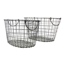 Country Lane Oval Baskets - Set of 2 - This set of 2 Country Lane Metal Baskets are versatile pieces. With its rustic character, the set straddles the design worlds of modern industrial and country chic. Each basket has handles for easy transport from market to kitchen to tabletop. Use them to store vegetables, display magazines or books, or hold rolled up tea towels in the kitchen.