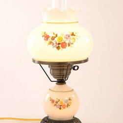None - Floral Hurricane Antique Brass Finish Table Lamp with Glass Shade - This beautiful floral Hurricane lamp features hand-blown glass and a frosted chimney with a clear top. An elegant antique brass finish completes the look of the lamp which also features a night light at the base.