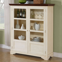 Monarch - Antique White / Walnut Veneer Display Server - This antique white display server has two shelves enclosed in glass doors making this piece ideal for storing kitchen supplies. With a walnut veneer top, this simple server will give your home a stylish update.