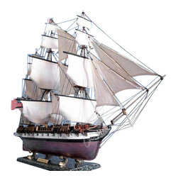 Handcrafted Nautical Decor - Uss Constellation Limited 37'' - Wooden Tall Ship Model - US Navy Vessel - Naut - SOLD FULLY ASSEMBLED--Ready for Immediate Display - Not a Model Ship kit--Finely-crafted details and museum-quality features define these Limited Edition scale replica tall ship models of the USS Constellation.Devoted attention to historical accuracy ensures that every detail on the USS Constellation matches the US Navy fighting tall ship as she still rests today in the Baltimore Inner  Harbor.As the centerpiece of a den, office or meeting room, or perhaps setting a patriotic nautical tone for a family living room or corporate boardroom, this Limited Edition tall model ship is certain to inspire with her indomitable spirit and patriotic history.--37'' Long x 12'' Wide x 28'' High (1:100 scale)----    Built from      scratch over      hundreds of hours by master artisans--    High quality      woods include      cherry, birch, maple and rosewood--    Individual wooden planks used in hull construction--    Meticulous      painting      accurately matches the real USS Constellation      --    Museum Quality features not available in other tall ship models under $3,000 or      any kit--    --        Accurate beakhead design and       scrollwork--        Increased detail of deck       features, cannon carriages, painting and other features--    --    --    Extensive rigging features over 200 blocks and      deadeyes--    Metal anchors weigh aside the bow--    Cannon carriages      tied-down to      deck to reduce recoil--    Amazing Details, including:--    --        Planked deck with nail holes--        Authentic scale lifeboats--        Rudder chains, cannonball       racks--        Solid brass cannons and metal       anchors --        Additional deck details such as cannon balls, barrels, etc.--        Masterfully stitched, heavy       canvas sails hold shape and do not wrinkle --        Taut rigging with varied       thread gauge and color--    --    --    L