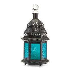 Glass Moroccan Lantern, Blue - Use these beautiful lanterns anywhere in your home. Glass and iron with intricate cutouts that are reminiscent of Moroccan treasures.