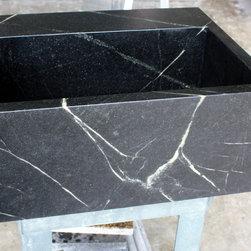 Soapstone Sinks - Soapstone farmhouse laundry sink fabricated by The Stone Studio