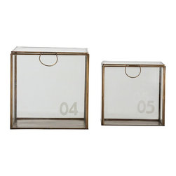 "Arteriors - Guthrie Boxes - Originally used by apothecaries, these glass storage boxes are perfect for displaying your collectibles. The frosted numbers originally helped the pharmacy keep track of the contents. They open from the top with a delicate metal ring handle.  No. 01 Large: 7"" X 7"" X 10 1/2"" h   No. 02 Medium: 5 1/2"" X 5 1/2"" X 7 1/3"" h  No. 03 Small: 4"" X 4"" X 5 1/2"" h  No. 04 Large: 9"" X 9"" X 9""  No. 05 Small: 7 1/2"" X 7 1/2"" X 7 1/2"""