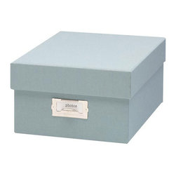 """Resource International Inc. - Margo Storage Collection Shoebox Photo Storage Box - Overview Our exclusive Shoebox Margo photo storage organizes and protects your valuable photo memories beautifully. Exposures has been designing museum-quality photo storage for 20 years. The photo file storage box is perfect for safekeeping your most treasured memories.  Features Bookcloth covering Standard nickel label holder Shoebox photo storage includes 24 acid-free photo envelopes, ID stickers and 4 glassine sleeves with room for up to 1000 4"""" x 7"""" photos    Fabric dye lots vary between shipments from our supplier, which may result in slightly varying colors when pieces are ordered separately.  When filling a piece of our storage furniture with boxes of the same color, we recommend you order all the pieces at one time to ensure color consistency. Specifications Photo storage box measures 5""""H x 8-1/2""""W x 11-1/2""""D."""