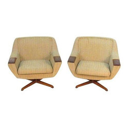 Used Mid-Century Swivel Lounge Chairs - A Pair - A pair of swiveling lounge chairs by Soda Galvano of Norway. They're in good overall condition, very comfortable and still have the original label attached. There is light wear on the fabric as to be expected from Mid-Century Modern pieces.