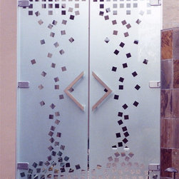 "Falling Squares Glass Doors - Falling Squares Glass Doors..... First impressions count!   ..... Glass Doors and Entries that Make a Statement.  Let Sans Soucie Art Glass transform the ordinary into the extraordinary with one of their signature frameless, all glass doors!  Glass front entry doors will be 1/2"" thick, while Interior glass doors can be 3/8"" or 1/2"" depending on the size, location and application.  Available any size, custom made to order, all glass is tempered for safety.   Interior glass doors will include wall mount hinges and solid metal door pulls.  Glass front entry or exterior doors will include top and bottom metal rails or patch fittings, header with concealed hydraulic closures, vertical jambs, lock box, threshold, back-to-back door pulls, all hardware (in a variety of finishes) and weather stripping and mohair door seals.   While any effect is possible on these doors, the majority of our clients who select frameless glass doors opt for the 3D carved option where the design is sculpted and will have a relief texture of varying depths. Glass is hand-crafted, sandblast frosted and 3D carved, art glass doors by Sans Soucie add a truly unique element and level of luxury, while providing privacy AND light!   From a little to a lot, the privacy you need is created without sacrificing sunlight.     From simple frosted glass effects to our more extravagant 3D sculpture carving, painted glass .. and everything in between, Sans Soucie designs are sandblasted different ways which create not only different effects but different levels in price.  The ""same design, done different"" - with no limit to design -  there's something for every decor, regardless of style.  Price will vary by design complexity and type of effect:  Specialty Glass and Frosted Glass.  For complete descriptions of glass types and effects, click here. Available any size, custom made to order and shipping worldwide at reasonable prices,   The sandblast artist literally cuts deep into the glass, using sand as their sculpting tool.  The edges of the carving illuminate bright as they pick up and reflect the surrounding light.   If color is desired, the 3D carved glass is airbrush painted in either translucent or solid paints, from matte to metallic.   Sans Soucie has hundreds of glass door designs available from simple to extravagant, and we specialize in creating new, custom designs specifically designed for your front entry."