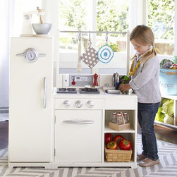 Simply White All-In-1 Retro Kitchen - We've combined all the well-loved elements from our individual Retro Kitchen pieces into one multifunction play center. A little cook's dream come true, it's a stove, oven and refrigerator all in one with tons of interactive opportunities – knobs turn, doors open and the sink is watertight for real cleanup.