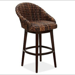 "Seagrass Bucket Swivel Barstool, Tall, Honey - Incredibly durable, renewable, and rich in tonal variation, woven seagrass and abaca bring a relaxed style to the dining area. Our swiveling barstool's generous barrel seat is woven by hand to create a spacious, comfortable spot to linger. Medium: 23"" wide x 24.5"" deep x 37.5"" high Tall: 23"" wide x 24.5"" deep x 41.5"" high Crafted with a kiln-dried mahogany frame and legs. Seat is fully wrapped in natural fiber; swivels 360 degrees. Color variations are inherent in the natural plant fibers used in our seagrass collection. The result may be differences in color tone from that shown. View our {{link path='pages/popups/fb-dining.html' class='popup' width='480' height='300'}}Furniture Brochure{{/link}}."