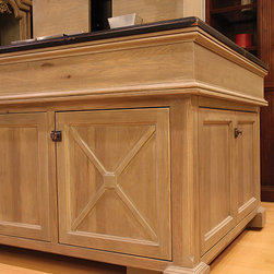 New Products and Designs - This island features a TV Lift and Beverage Center.  It rotates 360 degrees. The island is constructed from Pecan and has our new finish Venetian Finish - Dusk - an authentic lime wash finish.