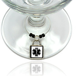 """Made on Terra - Star of Life Wine Glass Silver Charm - Your guests have arrived and the atmosphere is electric. A sip of wine here, a sip of a cocktail there and you find the conversation turning to the charming baubles you've placed on the glasses, something special you chose for each of your eclectic guests. They love them and appreciate your thoughtfulness. You love them for their uniqueness and that no one forgets which glass they were using.  Choose from Made on Terra's many designs for the best party ever. Ring is 1"""" diameter; measures 2"""" from top of ring to bottom of charm. Made of metal and plastic. Sold individually."""