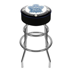 Trademark Global - Padded Bar Stool w NHL Throwback Toronto Mapl - Traditional excellence. Nostalgic Toronto Maple Leafs backless bar stool features the team logo from 1940 - the heyday of perhaps the NHL's most storied franchise. Round padded seat is upholstered with soft vinyl, while steel base has chrome accents for added appeal. Adjustable levelers. Long lasting officially licensed NHL team logo. Great for gifts and recreation decor. 7.50 in. High padded seat. 30 in. High bar stool great for bar pub table and bars. Commercial grade vinyl seat. Chrome plated double rung base. 14.75 in. W x 14.75 in. D x 30 in. H (17 lbs.)This National Hockey League Bar Stool will be the highlight of your bar and game room.