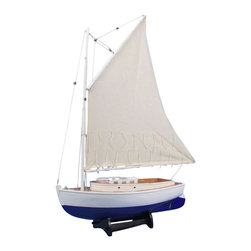 Handcrafted Nautical Decor - Mystic Sea Cat Sailboat Limited 30'' - NOT A MODEL SHIP KIT--Attach Sails and the Mystic Sea Cat Sailboat model is Ready for Immediate Display -- --Perfect for the nautical decor theme   of any sunroom mantle, bedroom shelf or office desk, the graceful lines   of these high quality model sail boats impress with their simple,   natural elegance. Wind and waves will take you away with this beautiful   model yacht.------    Handcrafted from solid wood by our master artisians--    Fine Craftsmanship, includes:--    --        High quality woods used in       construction of hull--        Beautiful, natural wood grain       clearly visible--        Delicately curved hull--        --        Thick, sturdy canvas used for all       sails--    --    --    Suits any room or      Decor with      clean lines and simple colors--    Pre-assembled, simply attach the masts and      display--    --        Ready to display in less than       five minutes--        Separate pre-assembled hull       and sails ensure safe shipping and lower cost--        Insert mast in designated hole       and clip brass rigging hooks as shown in illustrations--        Sails and rigging already       complete--    --    --
