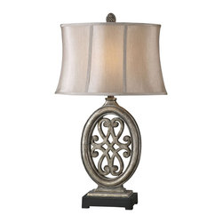 "Uttermost - Uttermost Barela Lamp 10 x 18 x 30.5"", Silver Leaf - Heavily distressed antiqued silver leaf finish accented with a matte black foot. The oval semi-bell shade is a silken champagne bronze fabric.Designer: David FrischWattage: 100WDimensions: 10"" depth by 18"" width by 30.5"" heightMaterial: poly/metal"