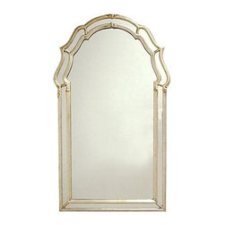 Consigned Italian Gilded and Silvered Mirror by La Barge - Elegant antiqued silvered mirror in double frame keyhole-form. Mirror panels and carved details make up the silver leaf frame which has gold overlay and dark antiquing. Made in Italy circa 1960s with the La Barge label attached.