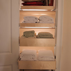 Pull Out Linen Shelves - ShelfGenie pull out shelves are custom made to fit your existing cabinets and closets, so wherever you have shelve or need shelves, think ShelfGenie of Indiana.  This linen closet features single-height and double-height shelves.  The double-height pull out shelves offer greater stability for stacks of items.