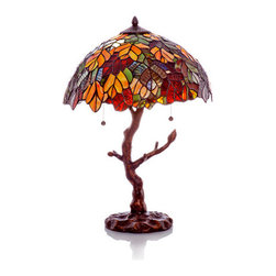 "24.5"" H Stained Glass Marvel Maple Table Lamp with Tree Trunk Base - Marvelous! This lamp features green, brown, and orange glass that forms vibrant leaves. It adds an elegant touch of nature to your living space. Accented by a tree branch base, this lamp brings the beauty of nature indoors."