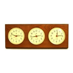 Bey-Berk International Brass Multizone Clock on Oak with 3 Brass Plates - Good taste is timeless, as evidenced by the Bey-Berk International Brass Multizone Clock on Oak with 3 Brass Plates. Synchronize your work hours with those of far-off locations, with these three timepieces, framed in brass and mounted upon solid oak. Features battery-operated, analog quartz movement.About Bey-Berk InternationalThis quality item is created by Bey-Berk. For more than 20 years, Bey-Berk International has crafted and hand-selected unique gifts and accessories from around the world to meet the demands of discerning customers. With its line of elegant and distinctive products, Bey-Berk has established itself as a leader in luxury accessories.