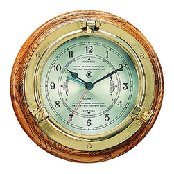 """Brass Porthole Quartz Tide & Time Clock - The brass porthole quartz tide  time clock measures 9.5""""Dia x 2""""D. This quartz tide  time clock comes in a solid brass tarnish proof case with beveled glass  an oak wood base. This beautiful instrument will accurately predict the tide cycles in your area  show time. It will add a definite nautical touch to whatever room it is placed in and is a must have for those who appreciate high quality nautical decor. It makes a great gift, impressive decoration  will be admired by all those who love the sea."""