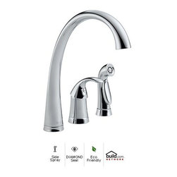 "Delta - Delta 4380-DST Chrome Pilar Pilar Side Spray Kitchen Faucet with - Product Features:    Made in the U.S.A. (Manufacturing plants: Greensburg, Indiana; Jackson, Tennessee)Fully covered under Delta s limited lifetime warranty  All-brass faucet body and handle construction  Superior finishing process - faucet finish covered under lifetime warranty  Insulated side spray included  Sleek design coupled with the latest valve technology  Spout swivels 180 degrees to allow for unobstructed sink access  High-arch gooseneck spout further allows for unobstructed sink access    Product Technologies:    Diamond Seal: Delta DIAMOND Seal Technology utilizes a ceramic disc valve with a real diamond coating to produce a faucet that will last up to 5 million uses. That s an amazing 10 times the industry standard, guaranteeing a lifetime of leak-free, trouble-free performance.  Eco Friendly: Through a number of technologies and innovations, Delta's Eco Friendly faucets achieve the impossible: A faucet that feels like more water, while actually conserving water. There are many advantages to this beyond helping protect our nation's water resources. First, Delta's Eco Friendly faucets splash less; you won't have to wipe your counters as much. Second, they use less hot water, preserving your hot water supply and reducing associated water-heating costs. Third, you will feel a little less guilty leaving the water running for longer periods.    Product Specifications:    Overall Height: 13"" (measured from counter top to highest point of faucet)  Spout Height: 9-3/4"" (measured from counter top to faucet outlet)  Spout Reach: 10-1/2"" (measured from center of faucet base to center of faucet outlet)  Number of installation holes required: 3  Center-to-center distance between handle ins"