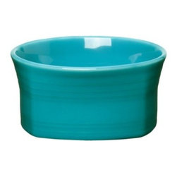 Fiesta Turquoise Square Soup / Cereal Bowl - Set of 4 - Picky eaters will have no trouble working up an appetite when faced with the Fiesta Turquoise Square Soup / Cereal Bowl - Set of 4. These cheerful yet peaceful bowls sport a jeweled glaze that will make any food look delicious. The unique square design of this deep, straight-sided bowl adds some whimsy to the table, and you already know that happiness is good for digestion. Made from fully vitrified china with a lead- and cadmium-free glaze, each piece is microwave-, dishwasher-, and freezer-safe, and oven-safe up to 400 degrees Fahrenheit.About FiestaAmerica's favorite dinnerware line, Fiesta was introduced by the Homer Laughlin China Company in 1936 and quickly became a collector's item. Sets of Fiestaware are passed down from one generation to the next, as their Art Deco patterns have a timeless beauty, and their durable construction survives lifetimes of everyday use. Made from strong restaurant-quality ceramic with a rainbow of vibrant-colored lead- and cadmium-free glazes, and a full assortment of practical shapes, this line of kitchenware is easy to mix and match to create your own custom set. Fiestaware patterns have remained consistent throughout the years, although new pieces and colors are added, so modern cooks can customize and update their collection. Proudly made in America with a 5-year no-chip guarantee, each piece is microwave- and oven-safe, and dishwasher-safe for easy cleanup.