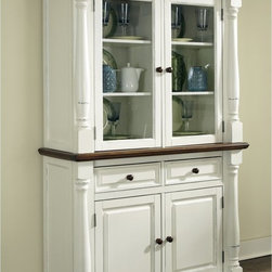 Home Styles - Home Styles Monarch China Cabinet - White & Oak - 5020-617 - Shop for Buffets and Side Boards from Hayneedle.com! You can safely store and proudly display your fine dinnerware and other treasures inside the Home Styles Monarch China Cabinet - White & Oak. A useful addition to a dining room this spacious cabinet consists of a top hutch and bottom buffet for generous storage. The buffet features two felt-lined drawers with dividers to organize silverware and utensils and there's a cabinet with two adjustable shelves for cups saucers place mats tablecloths and other items. You can display your favorite dishes behind the glass door cabinets on the hutch which has shelving to accommodate a variety of dining essentials. Constructed of hardwood solids engineered woods and veneers this china cabinet features a rubbed white finish and multi-step distressed oak finish. Crown moldings solid wood pilasters with intricate carved detail picture frame moldings and round metal hardware bring out the warm elegant style of this versatile piece. About Home StylesHome Styles is a manufacturer and distributor of RTA (ready to assemble) furniture perfectly suited to today's lifestyles. Blending attractive design with modern functionality their furniture collections span many styles from timeless traditional to cutting-edge contemporary. The great difference between Home Styles and many other RTA furniture manufacturers is that Home Styles pieces feature hardwood construction and quality hardware that stand up to years of use. When shopping for convenient durable items for the home look to Home Styles. You'll appreciate the value.