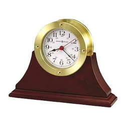Howard Miller - Howard Miller - South Pier Table Clock - Add a touch of the sea and a touch of class to your desktop with this impeccably designed time piece. With a finished Windsor cherry frame, white dial, and black Arabic numerals, this clock is unparalleled in its combination of form and function. Black hour and minute hands are combined with a red second hand to give you the precise time at any point in the day. With its Windsor Cherry finished frame, this Nautical Themed Brass Table Clock recalls the days when an accurate clock was a sea captain�۪s trusted friend. This elegant timepiece features easy to read numerals in deep black against a contrasting white background. * White dial. Black Arabic numerals. Black hour and minute hands. Red seconds hand. Glass crystal is surrounded by a bezel with satin brass finish, featuring decorative screws.. Finished in Windsor Cherry on select hardwoods and veneers.. Quartz movement includes battery.. H 5-3/4 in. (15 cm) x W 7-3/4 in. (20 cm) x D 2-1/4 in. (6 cm)