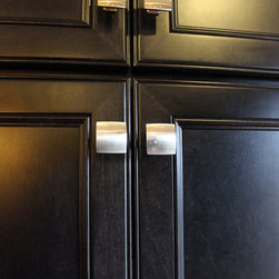 Kitchen Renovation, Medina, OH #3 ~ Medallion Cabinetry - This project was a total kitchen renovation with the removal of walls to opening up the floor plan. The cabinetry installed is Medallion Silverline Full Overlay Carlise Door Style stained cabinets in Maple with Onyx stain.  For the countertop Viatera Quartz surfacing was installed in Pishgah color with a double roundover edge.  The backsplash is 3x6 colour and dimension tile in bright Sandstone Beige with Glass Tile and Stone Bliss Moasic Accent.  This spacious kitchen/dining area is suitable for entertaining so the homeowner chose to add the Galley Workstation.  This is a 4' Galley sink with two top tiers, and includes a strainer, drain rack and cutting board.  The Galley can be used for food preparation, canning and packed with ice for a serving buffet.  The homeowner also installed a bar with a wine rack, a double oven, and seating off the kitchen island.